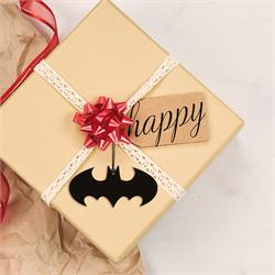 acrylic bat symbol being used as a gift package tag