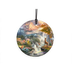 Bring the magic of Disney's Bambi to your window or festive wall with this StarFire Prints hanging glass. This collectible features Thomas Kinkade's panoramic painting, Bambi's First Year, done in Kinkade's instantly recognizable, luminous style.