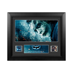 Relive the middle entry of Christopher Nolan's Batman Trilogy, The Dark Knight, with this limited edition FilmCells™ presentation featuring an image of the Joker with the backdrop of Gotham City, a certificate of authenticity, and two clips of 35mm film