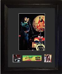 This Film Cell features an image of Bob Marley performing, as well as two film cells from his life.