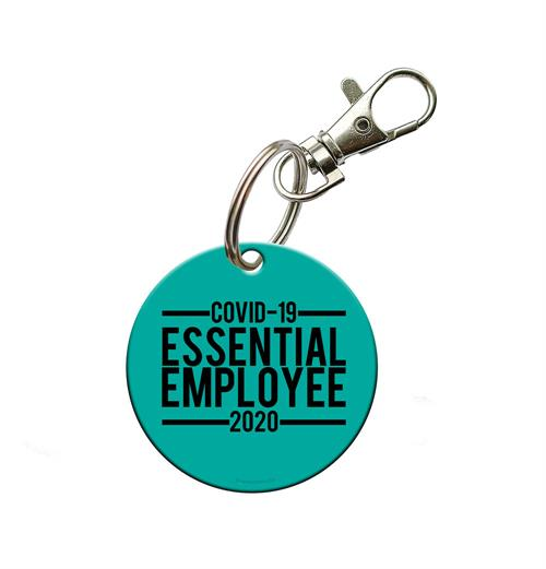 "This circular shaped acrylic keychain features the words ""COVID-19 2020 Essential Employee"" to represent those who are working on the front lines during the historical pandemic."