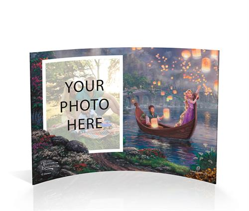 Flynn Rider watches while Rapunzel is enchanted by the glow of the paper lanterns. Disney's Tangled is featured in the instantly recognizable style of Thomas Kinkade Studios. The curved shape of this free-standing acrylic print