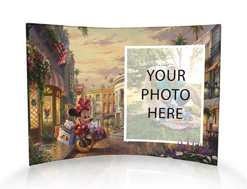 Thomas Kinkade Studios brings Minnie Mouse to Beverly Hills for some Rodeo Drive shopping! Minnie, in her sweet polka dots, balances several shopping bags after an exciting day of shopping. You can join in on the shopping fun too by uploading your image