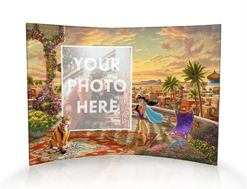 "Princess Jasmine and Aladdin twirl about underneath the Arabian sunset with the magic carpet seemingly cheering beside them on this personalized 10"" x 7"" curved acrylic print."