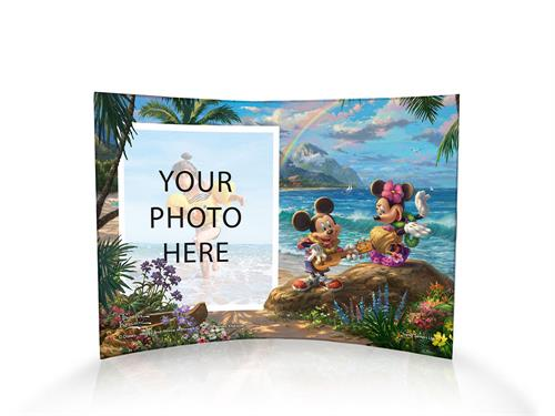 Disney's Mickey Mouse and Minnie Mouse hula on the Hawaiian shore in this officially licensed image by Thomas Kinkade Studios.  The officially licensed image is fused directly and permanently into the free-standing, light-catching acrylic print.