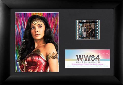 "! Featuring Diana Prince staring off into the distance in front of a neon backsplash, this 7"" x 5"" collectible item also holds one 35 mm carefully handcut film clip from the film reel of Wonder Woman 1984."