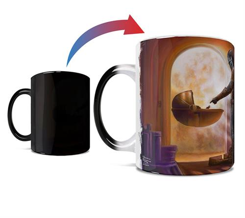 This 11 oz ceramic color changing mug displays the scene of Mandalorian Season 1 where Mando and Baby Yoda meet for the first time, touching hands.