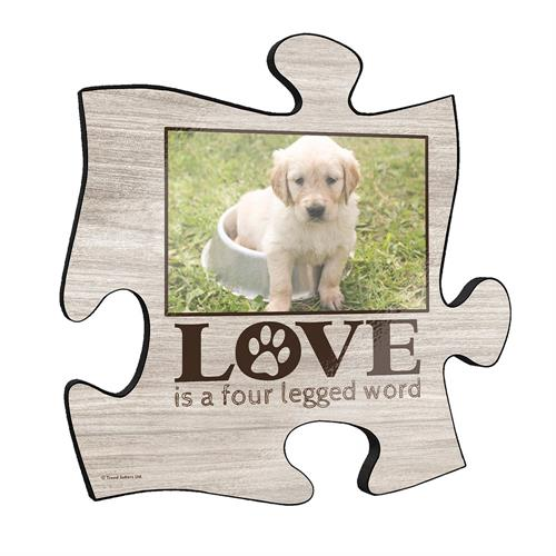 "This 12"" x 12"" puzzle piece shaped wall art allows you to upload a favorite photo of your beloved pet. Along with your pet's photo, this wall art also features a printed wooden pattern and the phrase ""Love is a four legged word."""