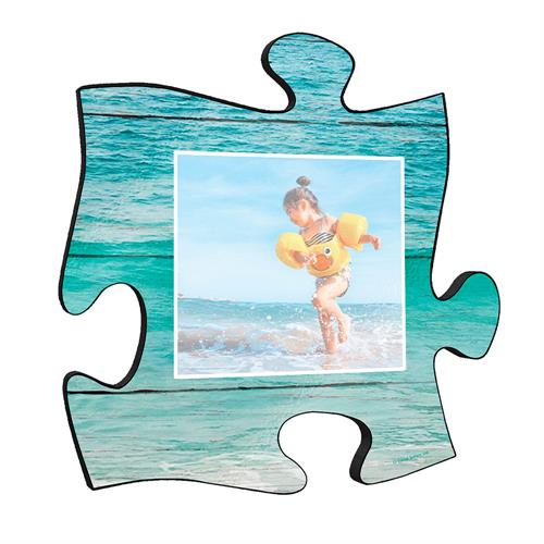 "Reminisce on your favorite beach trips with this 12"" x 12"" puzzle piece wall art. Printed onto this unique home décor is your favorite photo and a design of ocean waves framing the image."