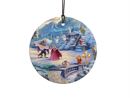 Indulge in the tale of Beauty and the Beast with this hanging glass decoration featuring artwork by Thomas Kinkade. A recent snowfall brings Belle, the Beast and their friends together to enjoy the beauty of winter. Belle and the Beast dance as Mrs. Potts
