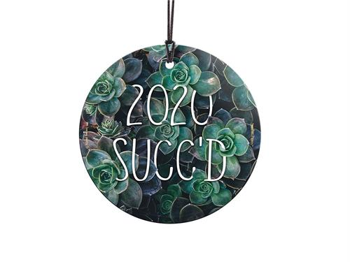 "It is no secret that the year 2020 sucked…. or as a plant lover may say: ""2020 Succ'd"". This 3.5"" hanging glass ornament features the punny phrase along with a background of beautiful thriving succulents."