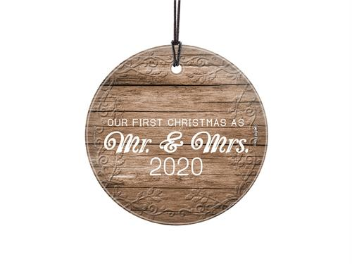 "This 3.5"" hanging glass decoration features a white wood design, the phrase ""Our First Christmas as Mrs. And Mrs."" and areas to customize the item with your wedding year."