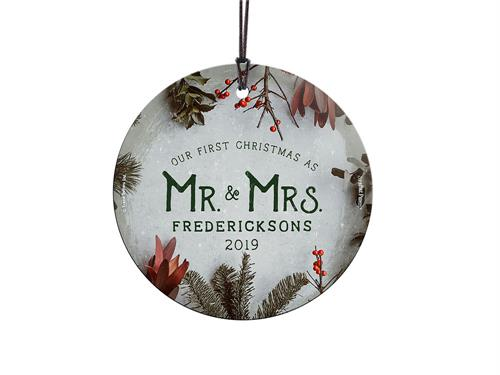Congratulations! You're celebrating your first Christmas as Mr. and Mrs.! This frosty image with winter greens and cranberries, featuring your family name and year, is fused directly and permanently into glass for a light-catching, long-lasting keepsake.