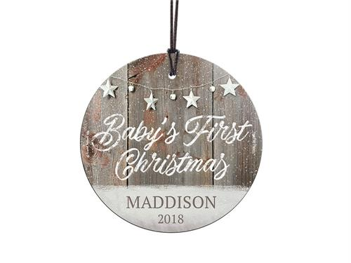 Celebrate a sweet little one's first Christmas with sweet snowy stars on a rustic background. This hanging decoration is made of glass for a long-lasting, light-catching display.