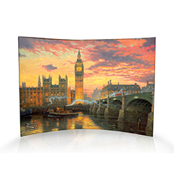 Thomas Kinkade's London comes to life on this curved acrylic print. Big Ben towers over the House of Parliament as the sun sets, reflecting across the River Thames while one of London's world-famous double-decker buses crosses Westminster Bridge.