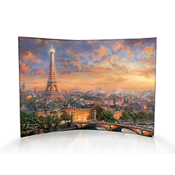 No other city is more iconically connected to romance than Paris, France. Thomas Kinkade's Paris, City of Love features an elevated view of the River Seine beneath the most romantic of all structures, the Eiffel Tower. The shimmering waters reflect the se