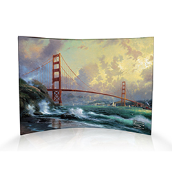 Thomas Kinkade's San Francisco, Golden Gate Bridge features the famous landmark as a fog lifts. Sail boats glide underneath on the waters of the bay while waves splash against the rocky shore. Bring the beauty of San Francisco into your home for the holid
