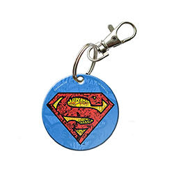 "Show your fandom for the Man of Steel with this circular acrylic keychain. Small images of past Superman comics on the keychain will delight all series fans as they carry the iconic ""S"" with them."