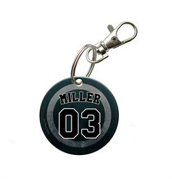 Show off the hockey star in your life with this personalized acrylic keychain. Put the name and number of your hockey player on this puck design and keep this on your keychain,