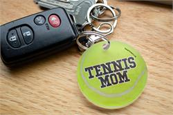 You're always there for their matches and show off your pride for your sports star however you can. Now, you can show that you're a proud tennis mom with this acrylic keychain.