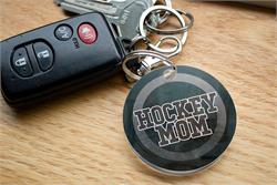 Goal! You're always there for their games and show off your pride for your sports star however you can. Now, you can show that you're a proud hockey mom with this acrylic keychain