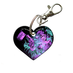 "POW! Harley Quinn looks as devilish as always on this 2"" heart-shaped acrylic keychain. The daring former psychologist stands out in purple hues as she holds a pistol against a black and aqua background."