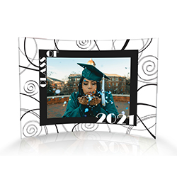 "Upload your graduate's image and personalize this 10"" x 7"" curved acrylic print by adding their graduation year. A fun framing of black and white swirl detailing give this piece a timeless retro vibe."