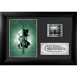 This FilmCells™ Presentation features a dramatic image of Grindelwald vs Dumbledore in the Deathly Hallows symbol on a mystical green background. Included on the easel-backed presentation is a high-quality image, a special edition card, and a clip of film