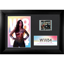 "! Featuring the vivid image of Wonder Woman posing in front of the WW84 logo and retro pastel hues, this 7"" x 5"" collectible item also holds one 35 mm carefully handcut film clip from the film reel of Wonder Woman 1984."