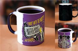 Attention K-Mart Shoppers!  Step right up! Test your strength!  Pour hot liquid into this officially licensed Beetlejuice Morphing Mugs® Heat-Sensitive Mug and it's … showtime!