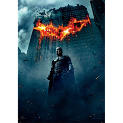 "Christian Bale looks regal as Batman on this 17"" x 24"" MightyPrint Wall Art. Featured on this print is Dark Knight in front of a building burning in the shape of the infamous bat shape."