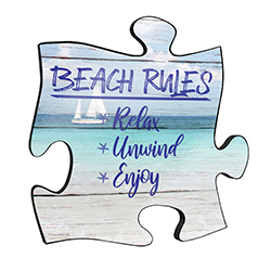 "Reminisce on your favorite beach trips with this 12"" x 12"" puzzle piece wall art. Printed on this unique home décor is the quote ""Beach Rules: Relax, Unwind, Enjoy,"" along with a scenic design of sailboats floating on the ocean."