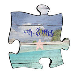 "Reminisce on your favorite beach trips with this 12"" x 12"" puzzle piece wall art. Printed on this unique home décor is a design of the ocean wave doodles with the text ""Mr. & Mrs."""