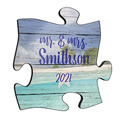 "Printed on this unique home décor is a design of the ocean and sandy beach along with a starfish with the text ""Mr. & Mrs."" with places to personalize with your last name and wedding date."