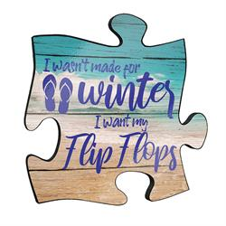 "Reminisce on your favorite beach trips with this 12"" x 12"" puzzle piece wall art. Printed on this unique home décor is a design of the ocean and the quote ""I wasn't made for winter. I want my flip flops!"""