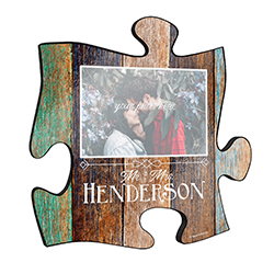 "Your marriage is beautiful and this unique personalized wall art is a wonderful way to show your favorite photo of you and your partner! This 12"" x 12"" wooden puzzle piece wall art allows you to add your favorite photo along with your last name."