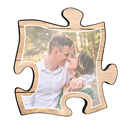 "Reminisce on your favorite beach trips with this 12"" x 12"" puzzle piece wall art. Printed onto this unique home décor is your favorite photo and a design of sand framing the image."