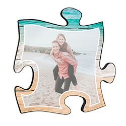 "Reminisce on your favorite beach trips with this 12"" x 12"" puzzle piece wall art. Printed on this unique home décor is your favorite photo and a scenic design of waves crashing onto the sandy beach frames the image."
