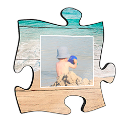 "Reminisce on your favorite beach trips with this 12"" x 12"" puzzle piece wall art. Printed on this unique home décor is your favorite photo and a design of the ocean waves framing the image."