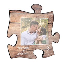 "This rustic style 12"" x 12"" wall décor has a realistic printed wood design and areas to add your favorite photo and the names of you and your partner."