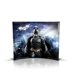 """There's a storm coming, Mr. Wayne."" Relive the storm set upon Gotham in The Dark Knight Rises, the final chapter of Christopher Nolan's Dark Knight trilogy, with this StarFire Prints™ curved glass photo featuring Batman against a backdrop of Gotham City."