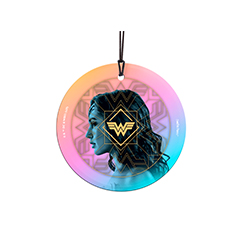 "Wonder Woman is back in the highly anticipated film, Wonder Woman 1984! This 3.5"" hanging glass accessory features the side profile of Diana Prince against pink and blue hues."