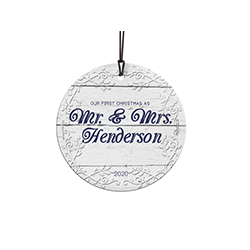 "This 3.5"" hanging glass decoration features a white Victoria design background, the phrase ""Our First Christmas as Mrs. And Mrs."" and areas to customize the item with your last name and wedding year."