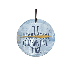 "This 3.5"" hanging glass decoration features the phrase ""The Honeymoon Quarantine Phase""."