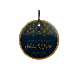 "This 3.5"" hanging glass decoration features Art Deco artwork with royal blue and gold accents, the phrase ""Our First Christmas Together"" and areas to personalize with your names and anniversary date."