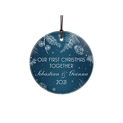 "This 3.5"" hanging glass decoration features a blue background with intricate white details, the phrase ""Our First Christmas Together"" and areas to personalize with your names and year."