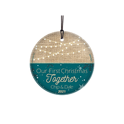 "This 3.5"" hanging glass decoration features a holiday lights and a teal snowflake design, the phrase ""Our First Christmas Together"" and areas to personalize with your names and year."