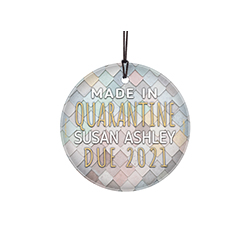 "This 3.5"" glass ornament is a great gift for the expecting parents. This hanging glass decoration reads ""Made in Quarantine"" along with a space to personalize with your child's name and his/her due date."