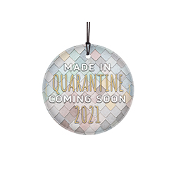 "This 3.5"" glass ornament is a great gift for the expecting parents. This hanging glass decoration reads ""Made in Quarantine"" along with a space to add your child's his/her due date."