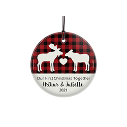 "This 3.5"" hanging glass decoration features a buffalo plaid background with a pair male and female moose, the phrase ""Our First Christmas Together"" and areas to personalize with your names and year."